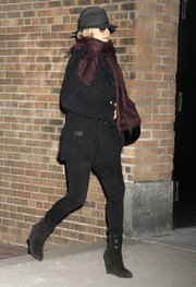 Jennifer Aniston bundled up in a black cardigan and a burgundy scarf for a day out in New York City.