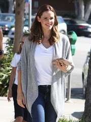 Jennifer Garner wore a gray wrap cardigan with a white T-shirt and jeans while picking up her children from school.