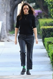 Jennifer Garner kept the rest of her look low-key with a pair of gray slacks and a black sweater.