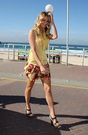 Jennifer wore a tiered floral mini skirt with a ruffled yellow blouse.