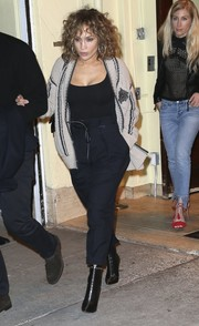 Jennifer Lopez teamed her cardigan with high-waisted navy pants and a skintight top.
