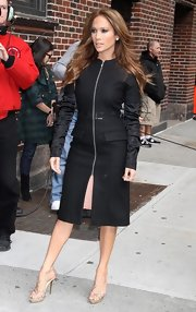 Jennifer Lopez showed off a zip-up trench coat while posing for the photog's outside the David Letterman show. J-Lo has never looked better.