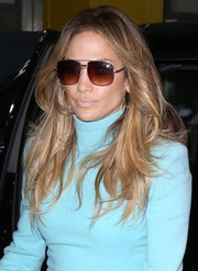 Jennifer Lopez was spotted out in NYC wearing a fabulous feathered flip.