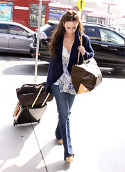 Jennifer carries all her travel essentials in this much needed LV monogram bag.