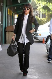 Jennifer showed off her leather Cocoon duffel while hitting Katsuya for lunch.