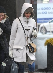 Jessica Alba stepped out on a cold day sporting a two-tone leather shoulder bag and duffel coat combo.