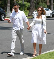 Jessica Alba attended a wedding looking elegant in an all-white skirt, camisole, and blazer combo.