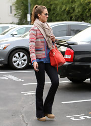 Jessica Alba gave her street style a '70s vibe with black flared jeans.