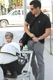 Cash Warren looked sporty in his black Lacoste shirt and gray jeans while out with his family.