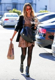 Jessica Alba was spotted in Santa Monica rocking an animal-print mini with a black blazer.
