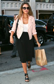 Jessica Alba stepped out in New York City wearing an edgy yet cute pink leather moto jacket by Rebecca Minkoff.