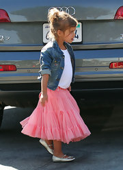 Honor Warren's silver ballet flats added some shimmer and shine to her bright ballet-inspired outfit.