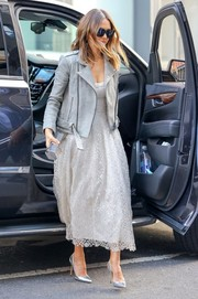 Jessica Alba styled her outfit with a futuristic silver clutch by Lee Savage.