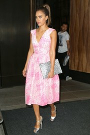 Jessica Alba paired her lovely dress with silver Brian Atwood Tribeca platform sandals.