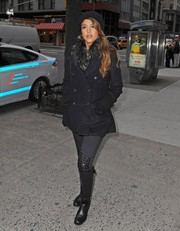 Jessica Alba sealed off her ensemble with black knee-high boots.