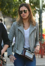 Jessica Alba was spotted out in New York City carrying a chic multicolored shoulder bag by Mary Katrantzou.