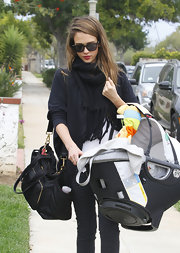 Jessica Alba wore this black scarf with chunky tassels to her Mommy and Me class with her daughter.
