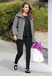 Jessica Alba added a playful touch with a pair of printed smoking slippers.