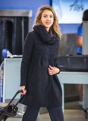 Jessica Alba bundled up in a cute black swing jacket for a flight to New York City.