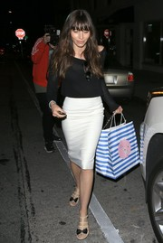 Jessica Biel paired her top with a white pencil skirt.