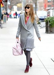 Jessica Biel matched her coat with a pair of gray tights.