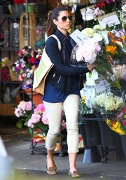 Jessica Biel was dressed down in a navy zip-up jacket layered over a plain shirt while out buying flowers.