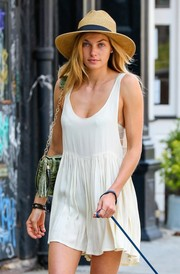 Jessica Hart paired a banded straw hat with a tiny white dress for a laid-back summer feel.