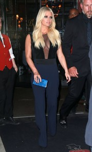 Jessica Simpson put on a busty display in a sheer-panel navy velvet and crepe jumpsuit by Galvan while out and about in New York City.