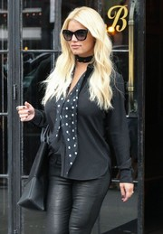 Jessica Simpson accessorized with a black-and-white polka-dot scarf by Saint Laurent for added cuteness to her daytime outfit.