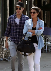 Jessica Szohr layered her denim, wearing a chambray button-up with a pair of white skinny jeans.