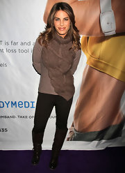 Jillian Michaels matched black knee-high boots with a brown turtleneck during the Consumer Electronics Show.
