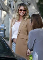 Chrissy Teigen looked hip in her aviators while out and about.
