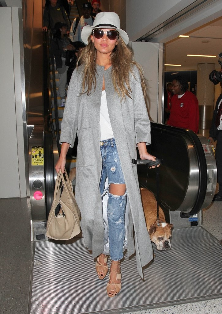 John Legend & Chrissy Teigen Touch Down At LAX With Their Dogs