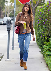 Jordana Brewster showed off her cognac suede booties by cuffing her medium wash skinny jeans.