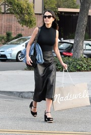 Jordana Brewster gave her outfit an edgy punch with a textured leather skirt.