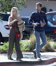 Diane Kruger wore a funky striped jumpsuit while out with hunky beau Joshua Jackson. She paired the ensemble with the 'Miss Wu' bag in red.