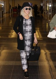 Julianne Hough chose a loose plaid jumpsuit for her comfy airport look.