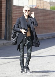 Julianne Hough styled her workout attire with a black shawl-collar yoga wrap by MPG.