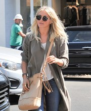 Julianne Hough went shopping in Beverly Hills wearing a pair of round shades.