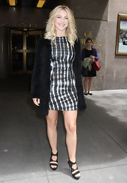 Julianne Hough topped off her black and white look with a classic black fur coat.