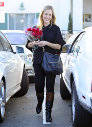 Julie Benz matched the relaxed vibe of her street look with a slouchy leather purse.