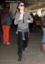 Juliette Lewis wore a pair of black sheepskin boots to the airport.