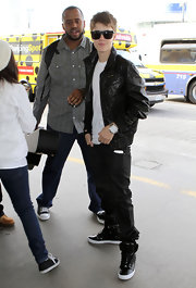 Justin wears a large statement watch with his black and white ensemble at the airport in LA.