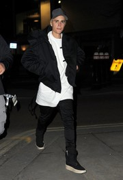Justin Bieber looked trendy in a black bomber jacket while enjoying a night out in London.