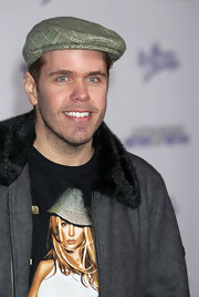Perez Hilton paired a plaid newsboy cap with a fur-collared jacket for the premiere of 'Justin Bieber: Never Say Never.'