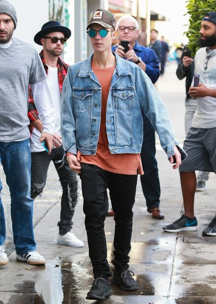 Justin Bieber stepped out in West Hollywood wearing a denim jacket over a rust-colored tee.