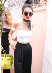 Kendall Jenner looked impossibly slim in a skintight white off-the-shoulder crop-top by Are You Am I while visiting the La Valencia Hotel.
