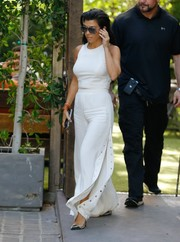Kourtney Kardashian was slim and chic in a fitted white crop-top while filming her reality show.