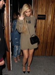 Kylie Jenner enjoyed a night out wearing a loose tan sweater dress by Yeezy.