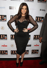 Khloe Kardashian gave her Althea Harper dress major attitude with fierce gold embellished black ankle booties.